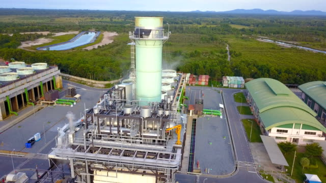 4k aerial shot of combine cycle powerplant and cooling tower in asia - synthpop stock videos & royalty-free footage