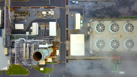 4k aerial shot of combine cycle powerplant and cooling tower in asia - turbine stock videos & royalty-free footage