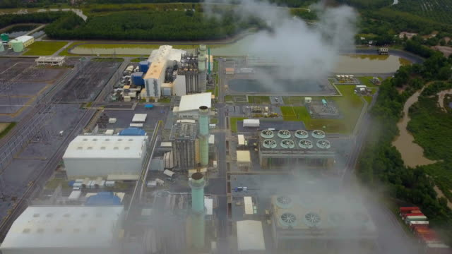 4k Aerial shot of combine cycle powerplant and cooling tower in Asia