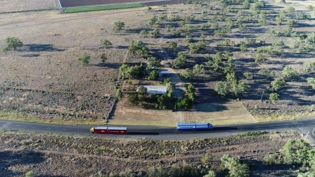 4k aerial shot of trucks on highway - hay truck stock videos & royalty-free footage