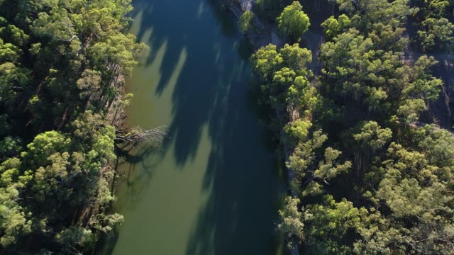 4k aerial shot over wide river - travelling light stock videos & royalty-free footage