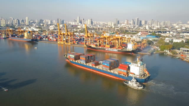 4k Aerial shot track of container ship at dockyard for logistic in ocean