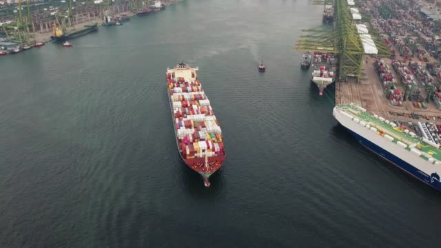 4k Aerial shot track of container ship in ocean of Singapore