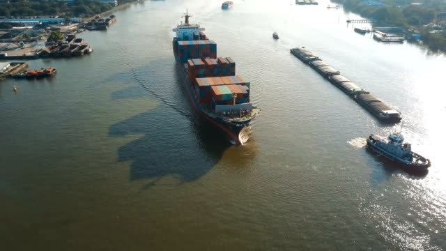 4k Aerial shot tracking of container ship for logistic in ocean
