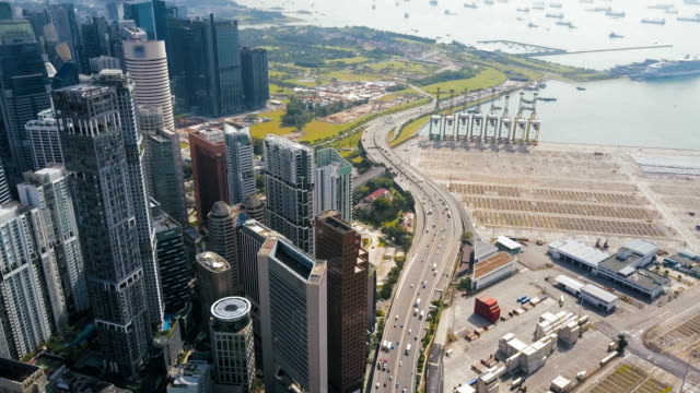4k Aerial vertical view of rooftop financial district buildings and highway