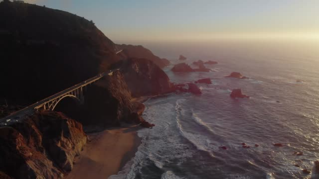 4k aerial video - bixby creek bridge at big sur coastline, california, usa - coastline stock videos & royalty-free footage