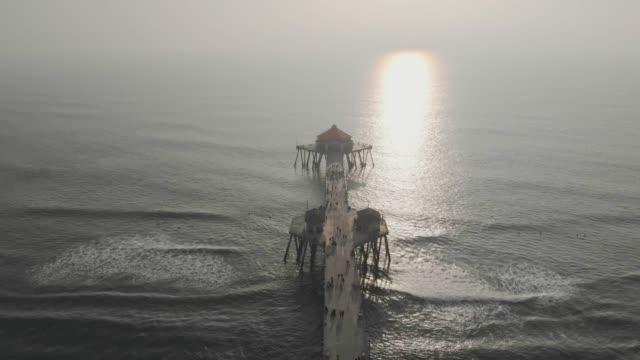 4k aerial video - huntington beach pier - huntington beach california stock videos and b-roll footage