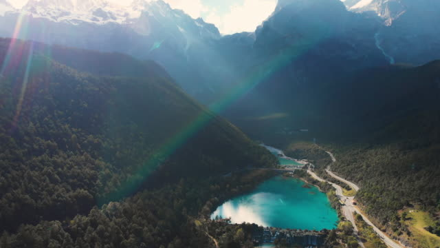 4k aerial view and crane shot of blue moon valley and jade dragon snow mountain in lijiang, china. - crane shot stock videos & royalty-free footage