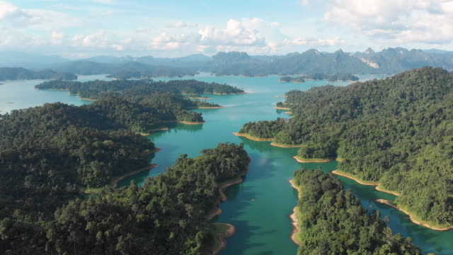 4k aerial view and dolly shot of tropical rainforest at Chiaw Lan Dam in Khao sok.