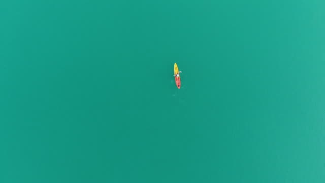 4k aerial view and flat lay of alone person kayaking in lake.