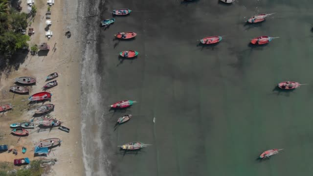 4k aerial view and zoom in of fishing boat. - flat lay stock videos & royalty-free footage