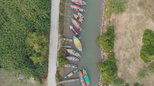 4k aerial view and zoom out of fishing boat. - flat lay stock videos & royalty-free footage