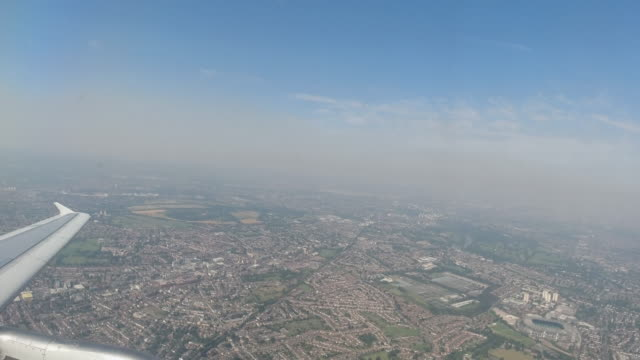 4k aerial view from aeroplane window over london 2 minutes after take off from london heathrow airport, united kingdom. showing twickenham stadium and out skirts of london on a bright summer warm day. - out take stock videos & royalty-free footage
