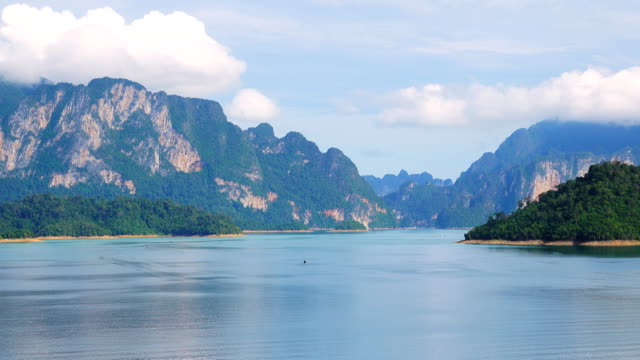 4k: aerial view long tail boat at cheow lan dam in khao sok national park. - panoramic stock videos & royalty-free footage