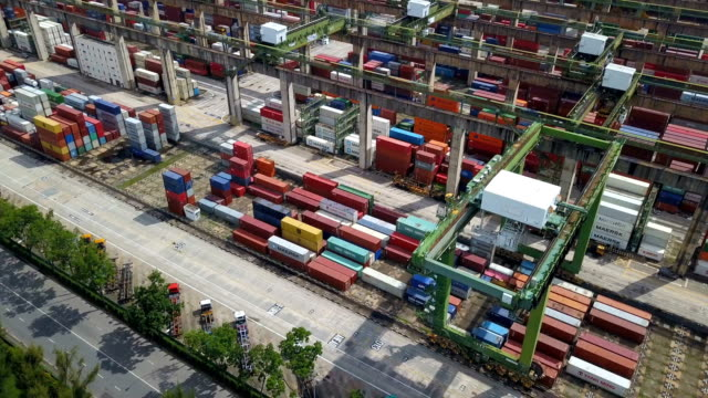 4k aerial view of industrial port with containers ship, south east asia - crate stock videos and b-roll footage