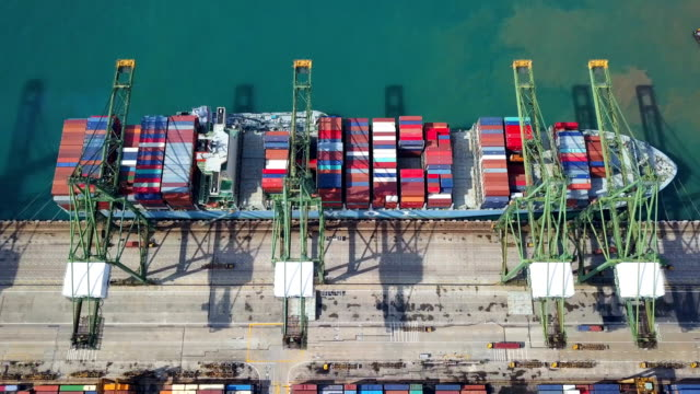 4k Aerial View of Industrial port with containers ship