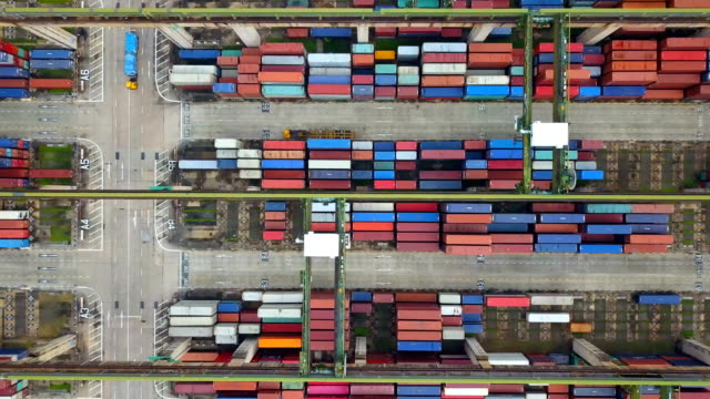4k aerial view of industrial port with containers ship - station stock videos & royalty-free footage