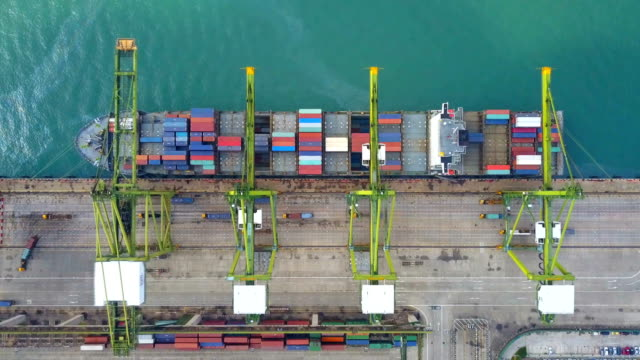 4k aerial view of industrial port with containers ship - cargo container stock videos & royalty-free footage