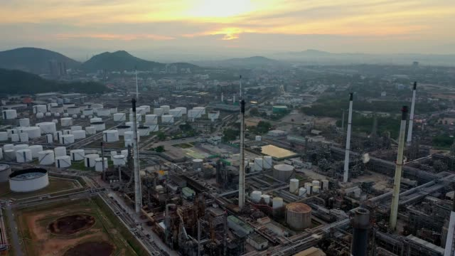 4k aerial view of large oil refinery facilities and storage tank in asia - refinery stock videos & royalty-free footage