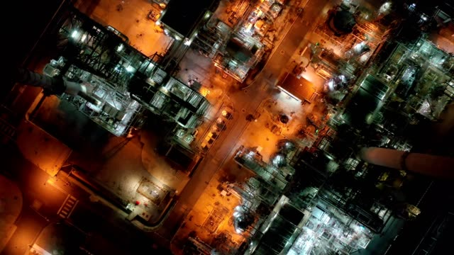 4k aerial view of large oil refinery facilities and storage tank in asia at night - oil refinery stock videos & royalty-free footage