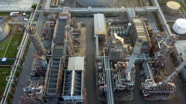 4k aerial view of large oil refinery facilities at morning in asia - chemical stock videos and b-roll footage