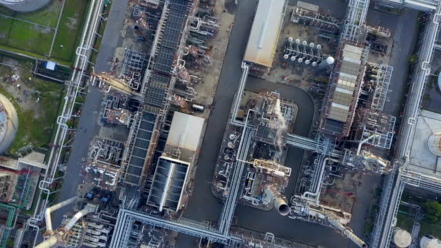 4k Aerial view of large oil refinery facilities at morning in Asia