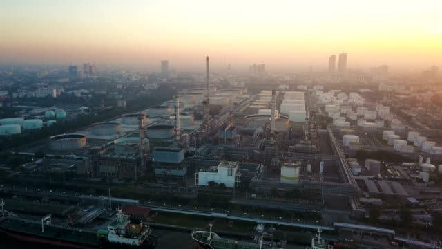 4k Aerial view of large oil refinery facilities at sunrise in asia