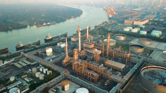 4k aerial view of large oil refinery facilities at sunrise in asia - gas pipe stock videos and b-roll footage