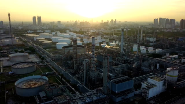 4k aerial view of large oil refinery facilities in asia - industrial district stock videos & royalty-free footage
