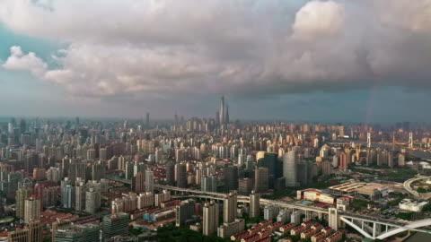 4k : aerial view of shanghai skyline with rainbow - urban sprawl stock videos & royalty-free footage