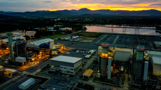 4k aerial view timelapse of combined cycle powerplant or fuel gas powerplant at night - synthpop stock videos & royalty-free footage