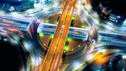 4k aerial view timelapse or hyperlapse night cityscape of highway in Bangkok