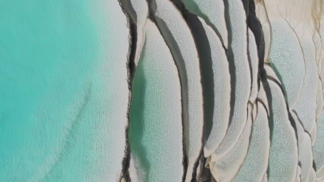 4k aerial view zoom out; abstract natural pattern of waterfall white water terrace in china. - natural pattern stock videos and b-roll footage
