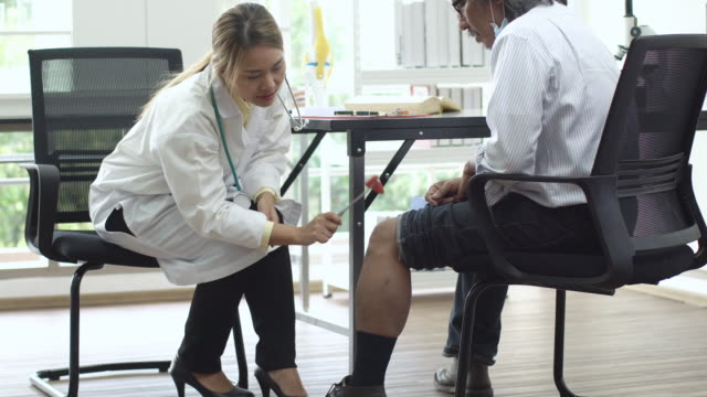 4k: Asian doctor and patient discussion about arthritis knee in hospital or clinic.