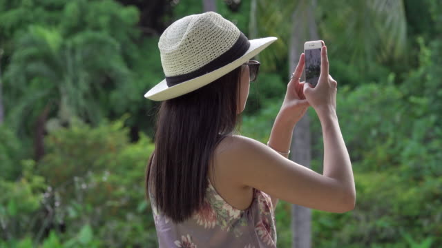4k: asian girl take a photo by smart phone - moving activity stock videos & royalty-free footage
