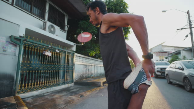 4k asian man runnner warm up and stretching before run. - warm up exercise stock videos & royalty-free footage