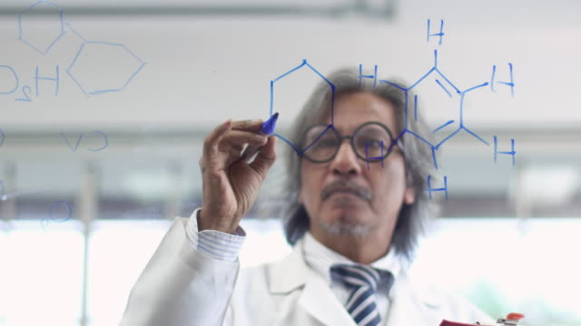 4k: asian scientist writing chemical formula on glass board. - hydrogen stock videos & royalty-free footage