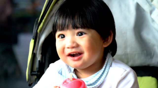 4k cu asian toddler drink juice via straw - chinese ethnicity stock videos & royalty-free footage
