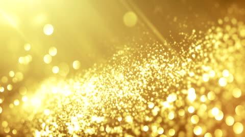 4k beautiful bokeh and light beams (bright gold) - loop - award stock videos & royalty-free footage