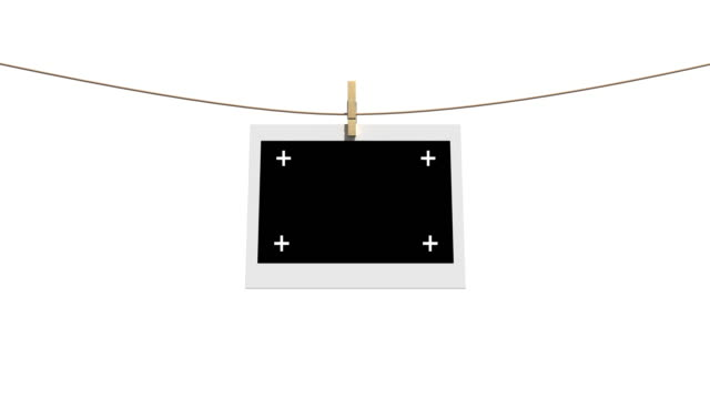 4k blank photos on the clothesline isolated with luma matte - polaroid stock videos & royalty-free footage