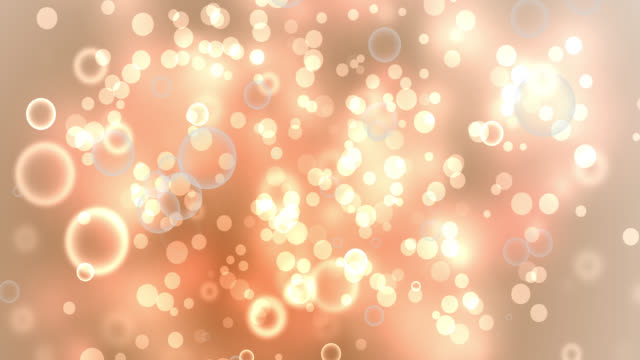 4k bubbles in water on orange lights background - orange stock videos & royalty-free footage