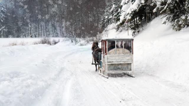 4k christmas snowflakes animation - horsedrawn stock videos & royalty-free footage
