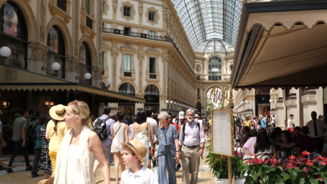 4k clip of tourists and locals shopping and having lunch in the famous galleria vittorio emanuele ii. - milan stock videos & royalty-free footage