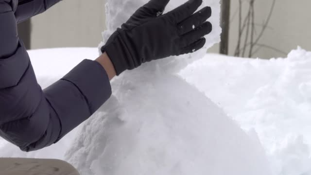 4k: close up doing snowball, making snowman, fun in snow - igloo stock videos & royalty-free footage