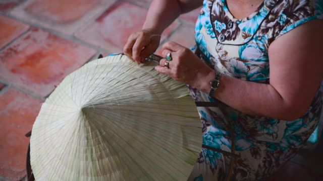 4k close up movie of hand making vietnamese hat - traditionally vietnamese stock videos & royalty-free footage