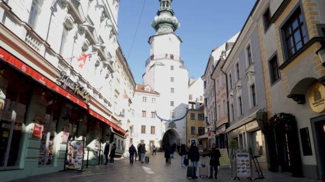 4k close up of michaels gate clock tower in bratislava slovakia. the only remaining gate of the old town fortress castle wall. - bildkomposition und technik stock-videos und b-roll-filmmaterial