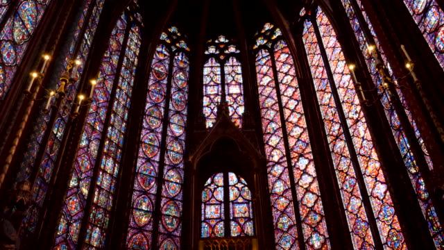 4k close up of sainte-chapelle ornate interior, 13th-century, gothic chapel with relics & notable stained-glass windows of biblical scenes. paris france - cathedral stock videos & royalty-free footage