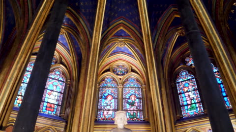 4k close up of sainte-chapelle ornate interior, 13th-century, gothic chapel with relics & notable stained-glass windows of biblical scenes. paris france - christianity stock videos & royalty-free footage