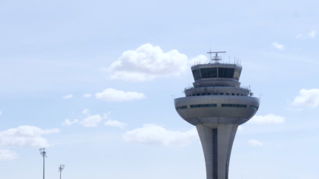 4k close up of the air traffic control tower at madrid-barajas adolfo suárez airport. - control stock videos & royalty-free footage