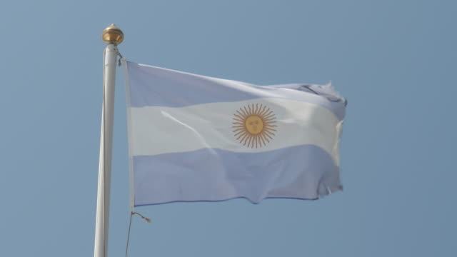4k close up slow motion of argentina national flag flying proudly in the wind on a warm beautiful bright summer day. - argentina stock videos & royalty-free footage